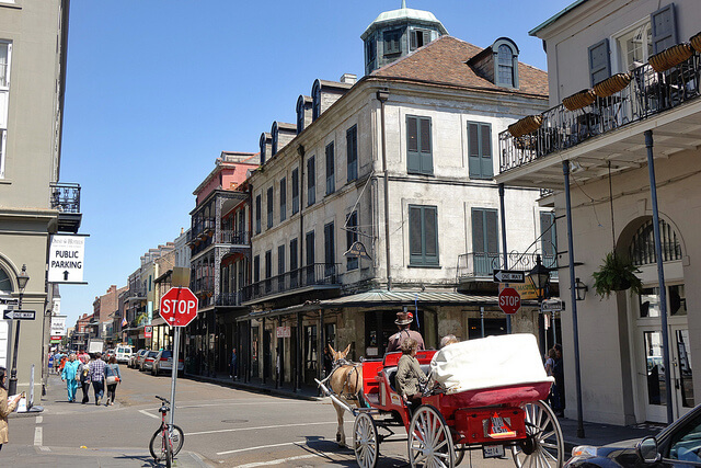 A carriage rolls past Napoleon House in the French Quarter. (Photo: Paul Broussard)